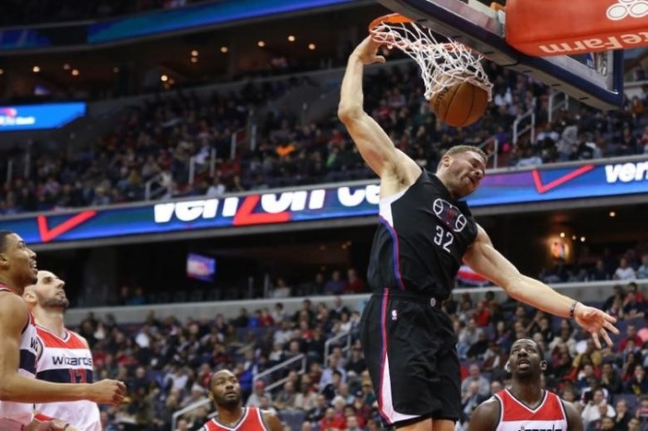 LA Clippers forward Blake Griffin (32) dunks the ball as Washington Wizards  guard John Wall (2) and Wizards forward Otto Porter Jr. (22) look on 627ac59ab