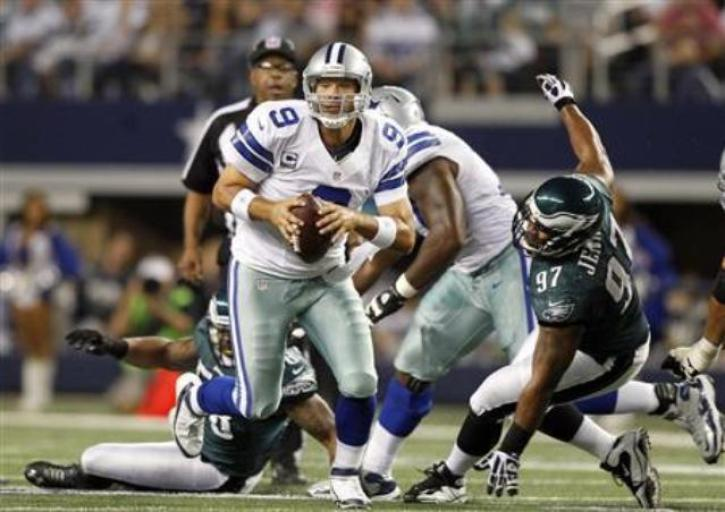 Dallas Cowboys quarterback Tony Romo scrambles as Philadelphia Eagles  defensive tackle Cullen Jenkins is unable to make the tackle in the first  half of ... 25dfbef6845